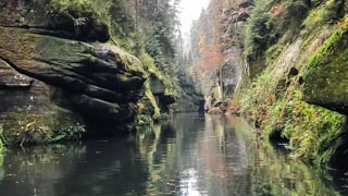 Romantic boat ride on the Kamenice River in Edmund Gorge, Bohemian Switzerland national park, Czech Republic